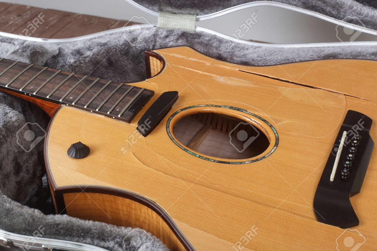 Musical instrument - Closeup fragment Broken acoustic guitar in hard case - 169810289