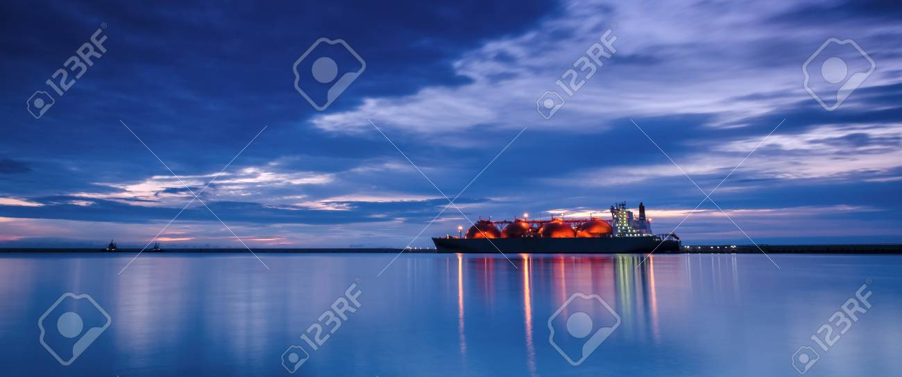 LNG TANKER - Sunrise over the sea gas terminal - 85842815