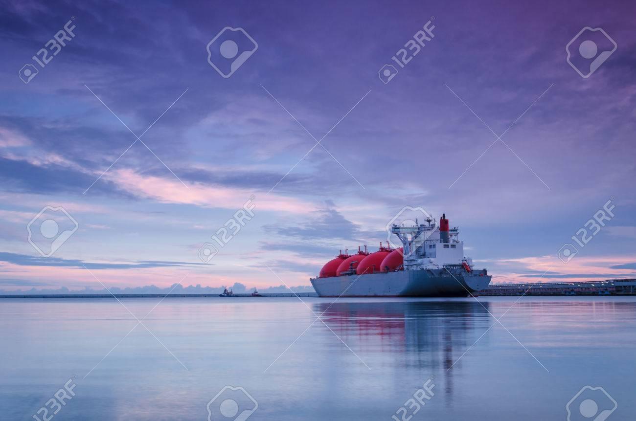 LNG TANKER - Sunrise over the sea gas terminal - 85806466