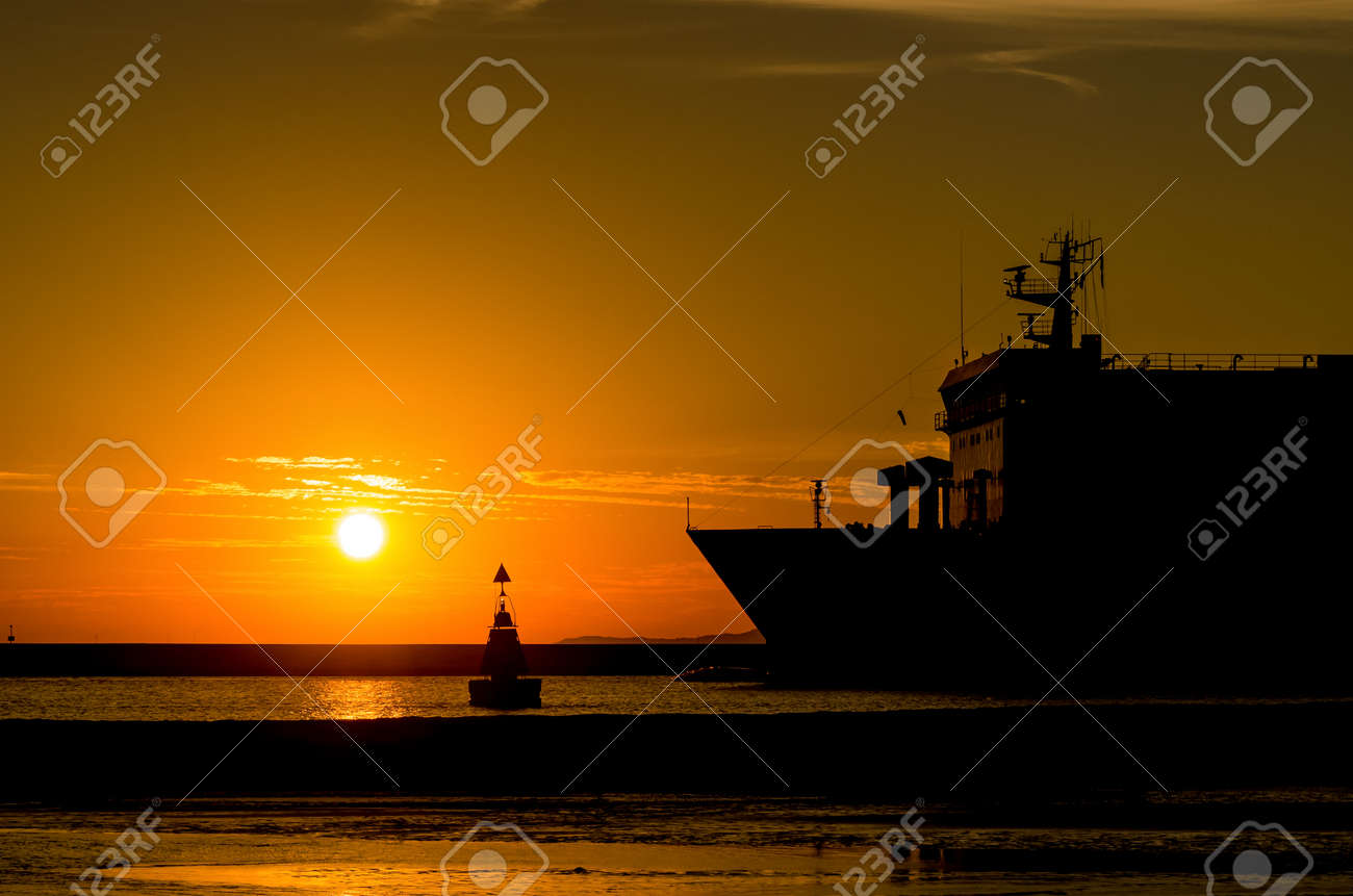 PASSENGER FERRY - Sunrise over a ship going on a sea cruise - 171403207
