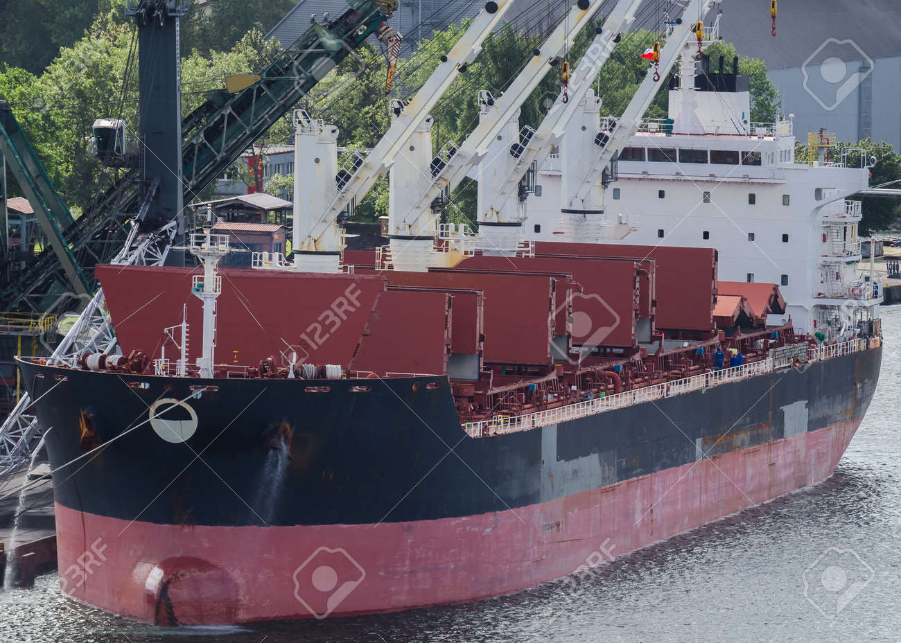 MARITIME TRANSPORT - Merchant vessel in seaport - 168433592