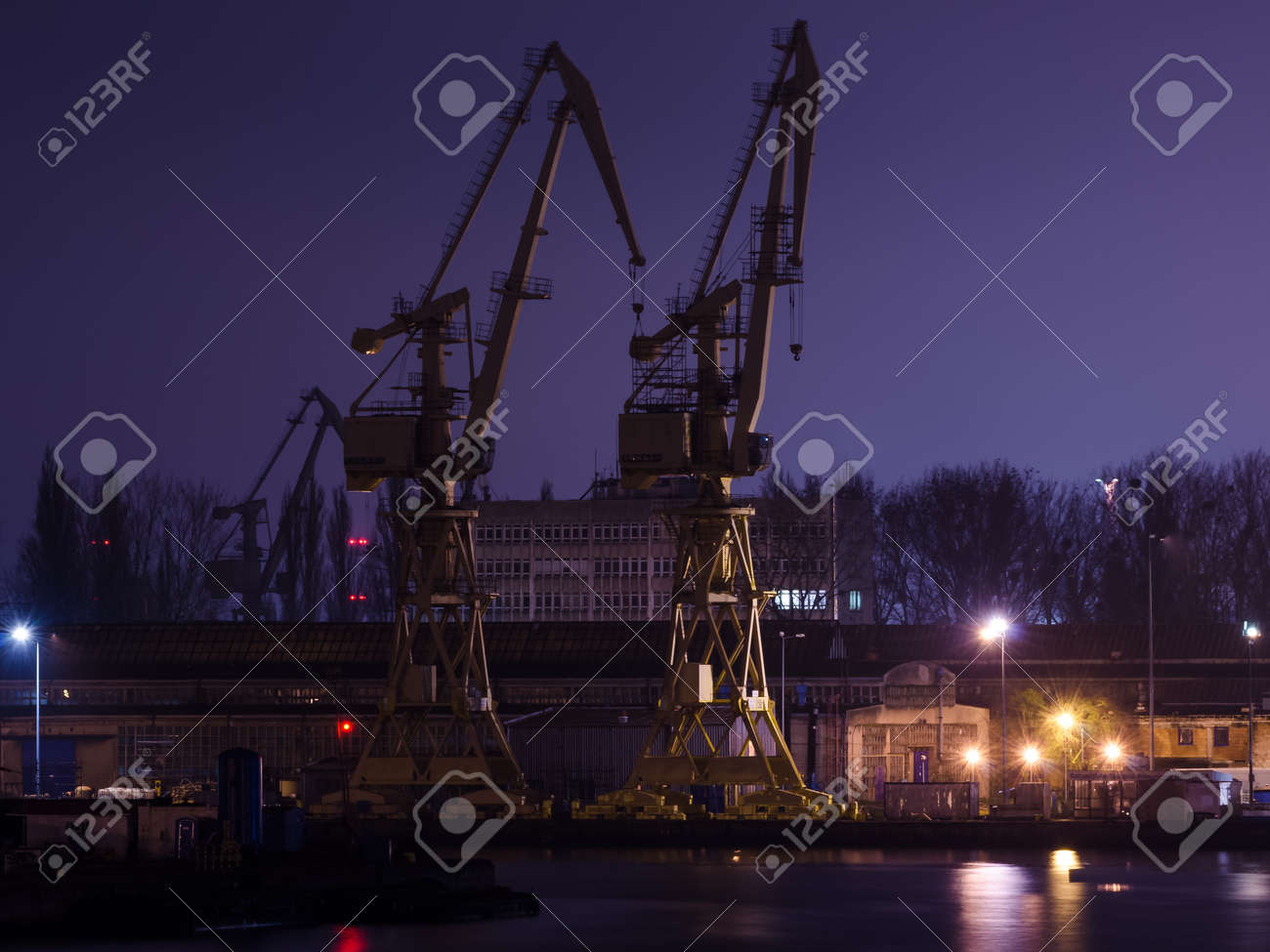 SZCZECIN, WEST POMERANIAN - POLAND - 2020: Shipyard cranes and quays at night - 168633088