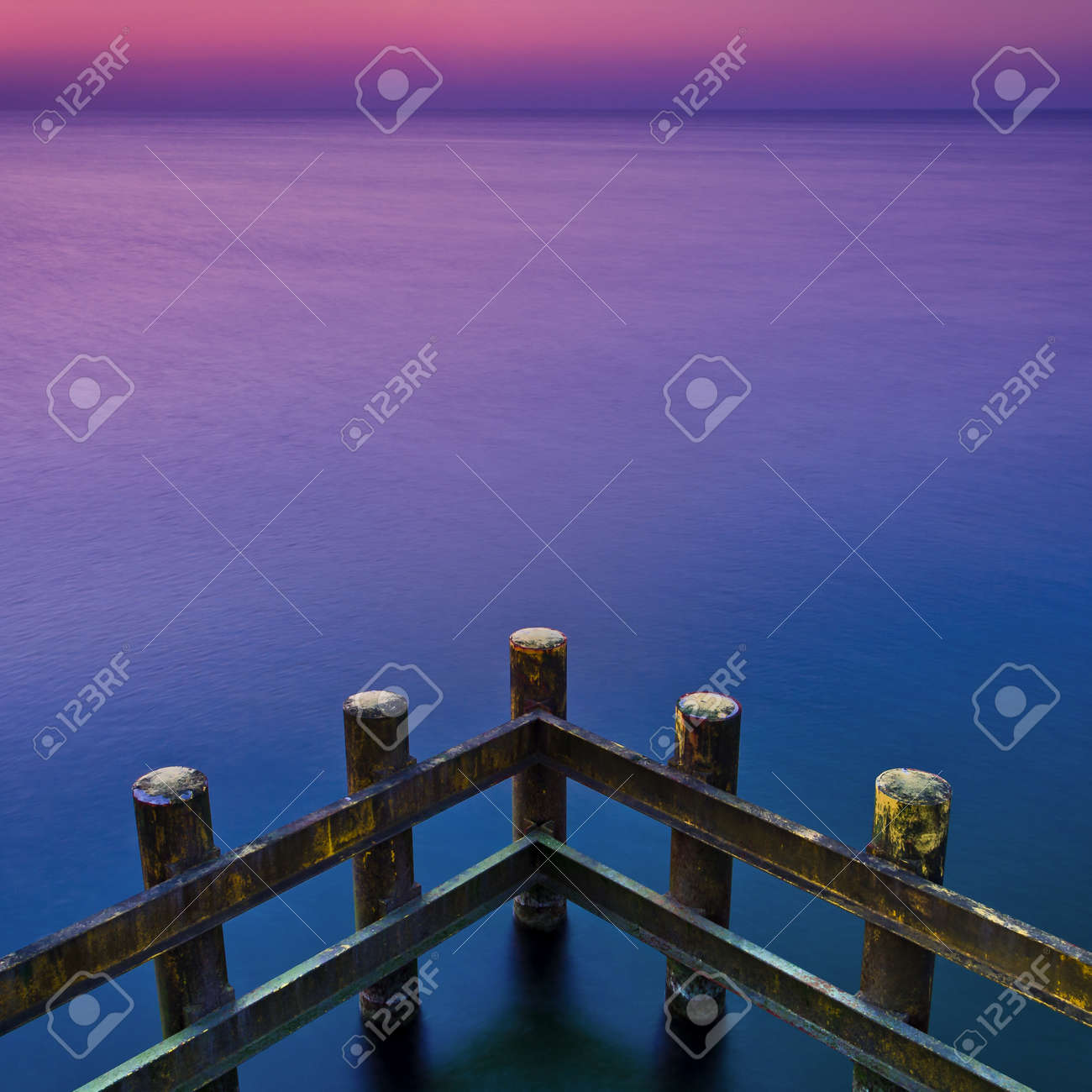 CONSTRUCTION ON THE COAST - Palisade protecting against sea waves - 169541040
