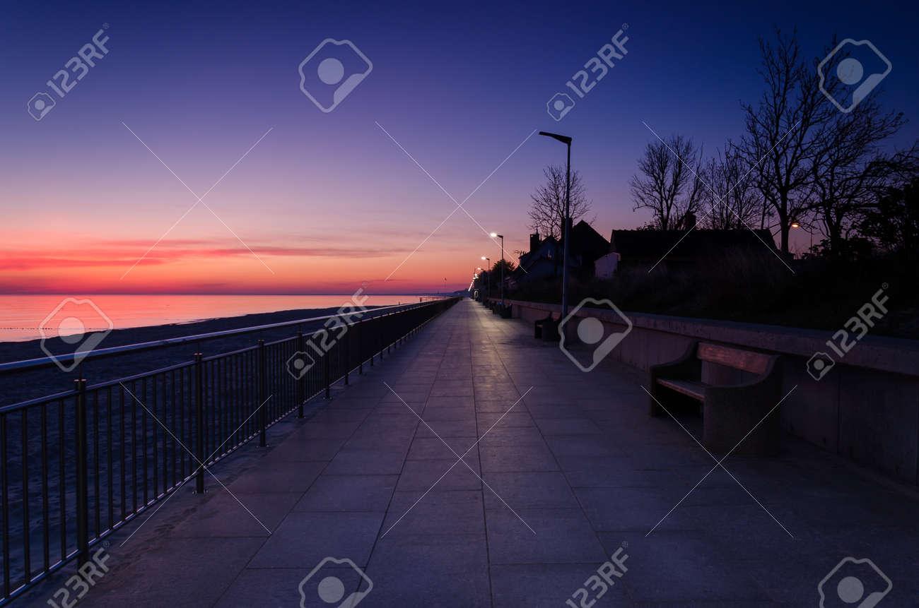 SUNRISE OVER THE SEASHORE - A colorful morning on the promenade - 169541051
