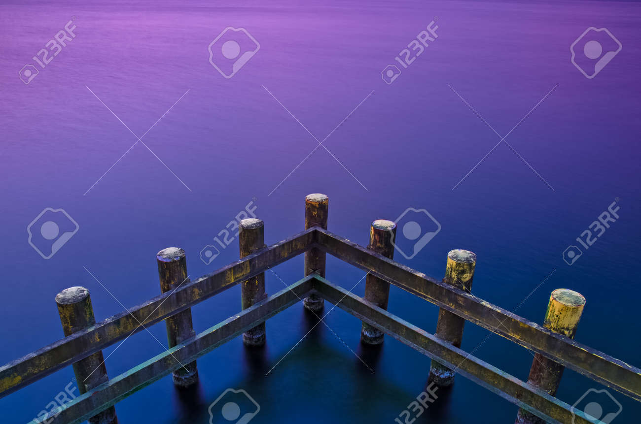 CONSTRUCTION ON THE COAST - Palisade protecting against sea waves - 169541113