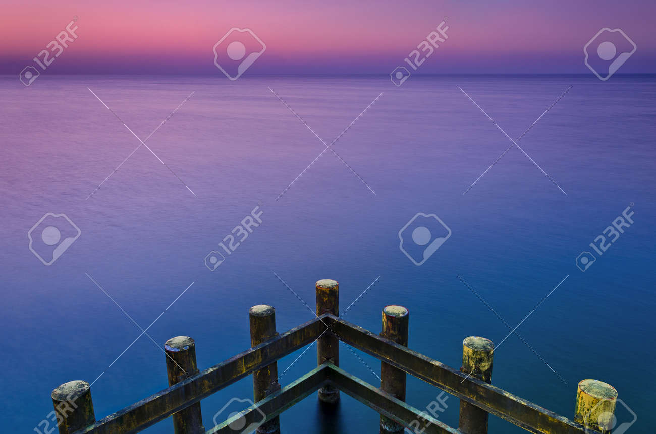 CONSTRUCTION ON THE COAST - Palisade protecting against sea waves - 169541139