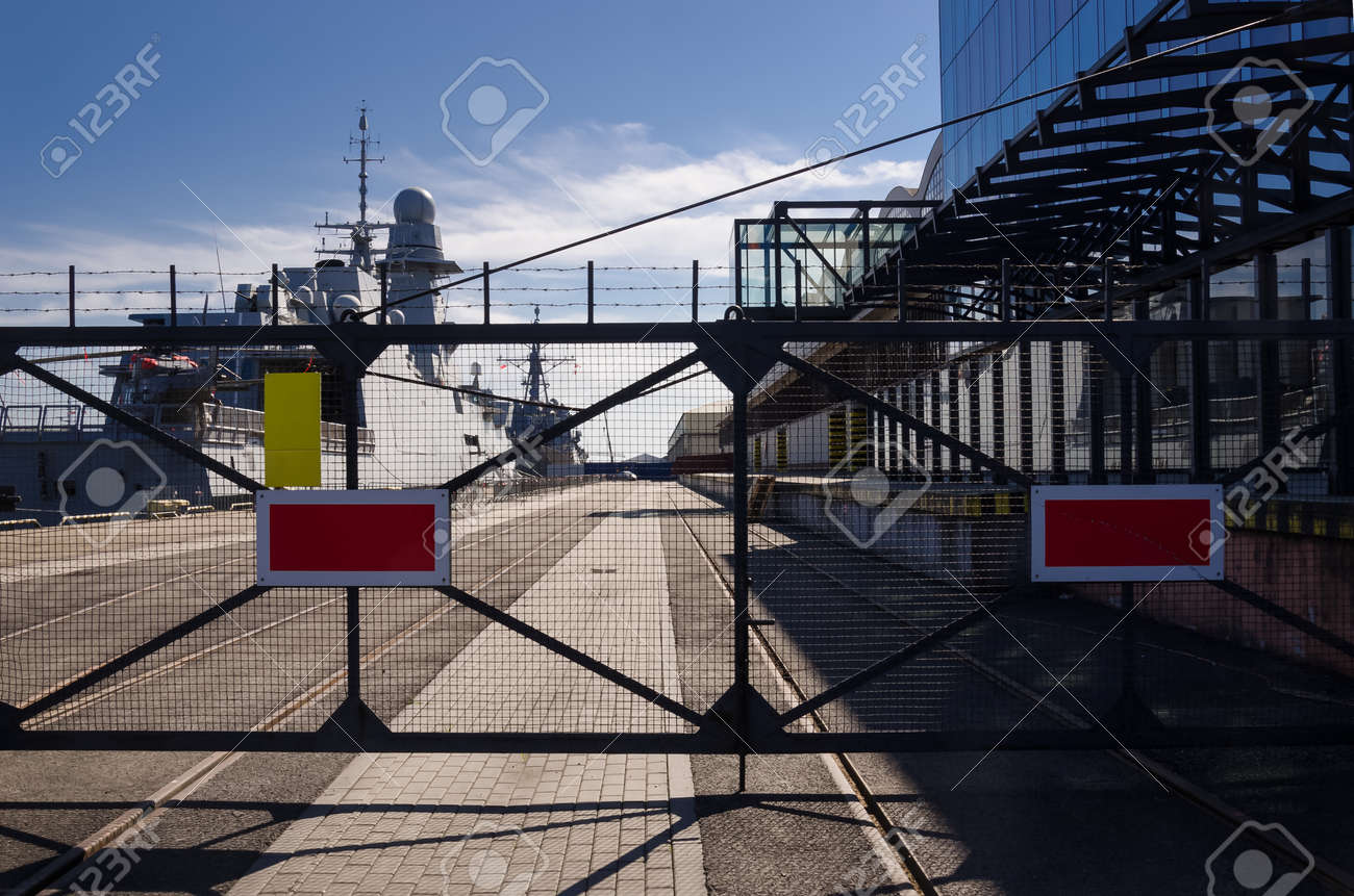 WARSHIPS - An Italian frigate and an American destroyer moored at a seaport wharf - 170697135