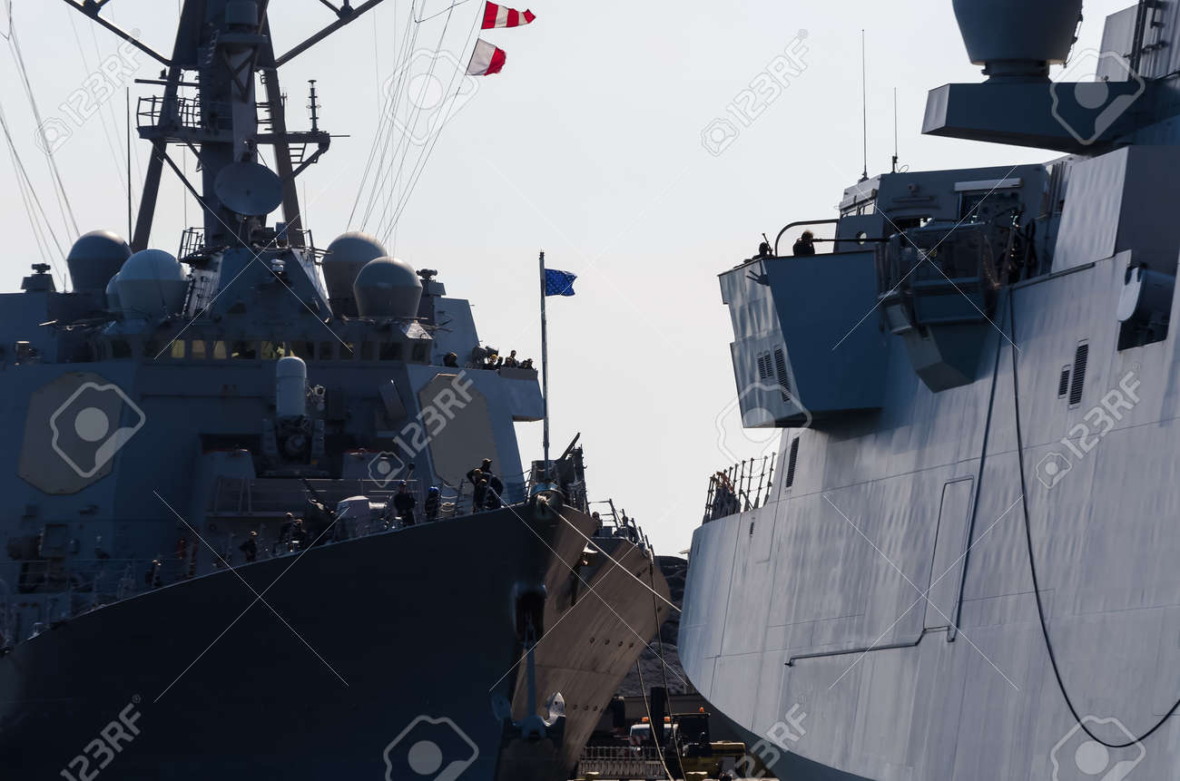 WARSHIPS - An Italian frigate and an American destroyer moored at a seaport wharf - 170697189