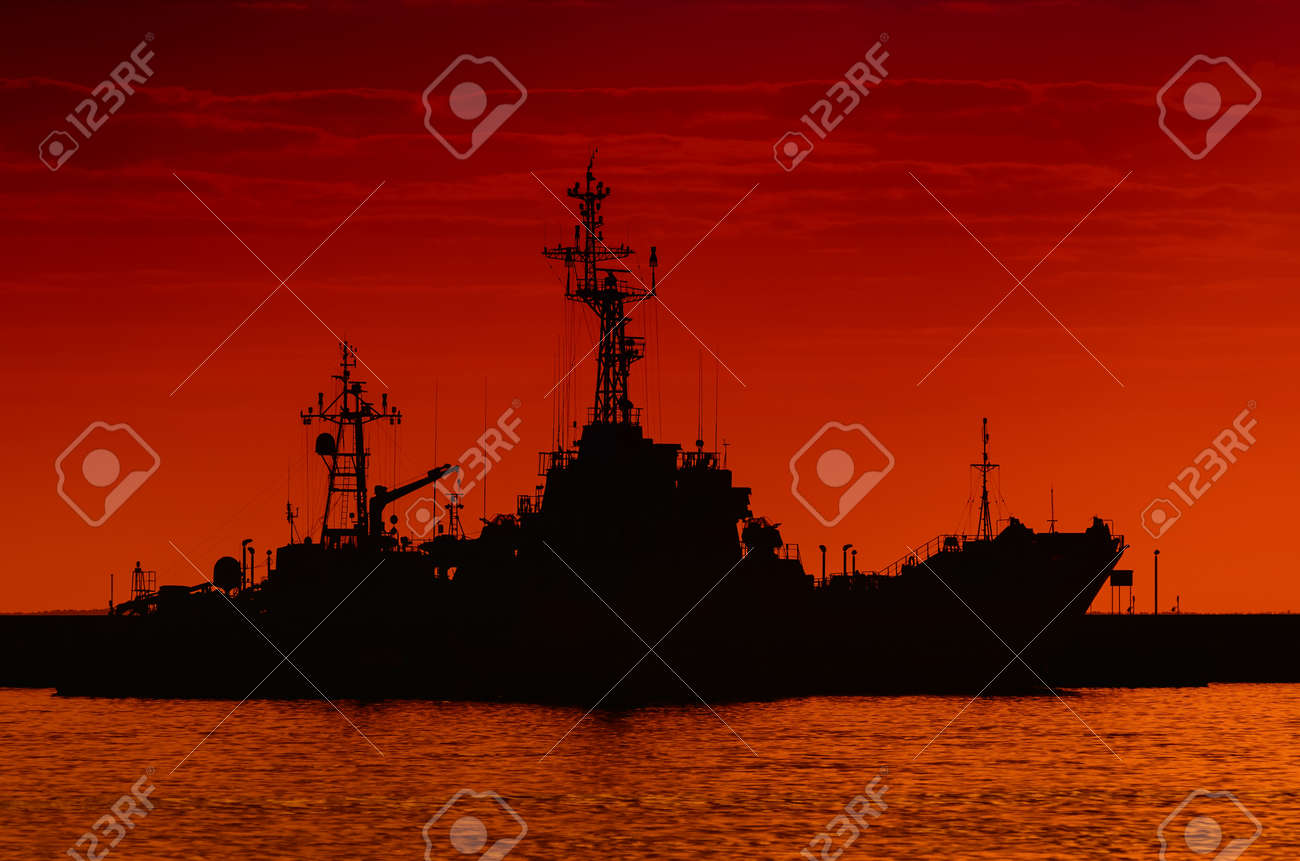 WARSHIPS - A fiery sunrise over the naval base - 170922842
