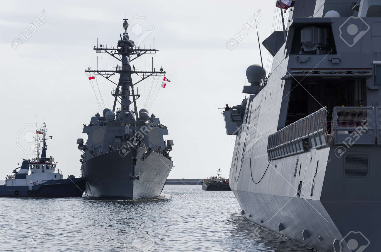 WARSHIPS - An Italian frigate and an American destroyer moored at a seaport wharf - 170922856