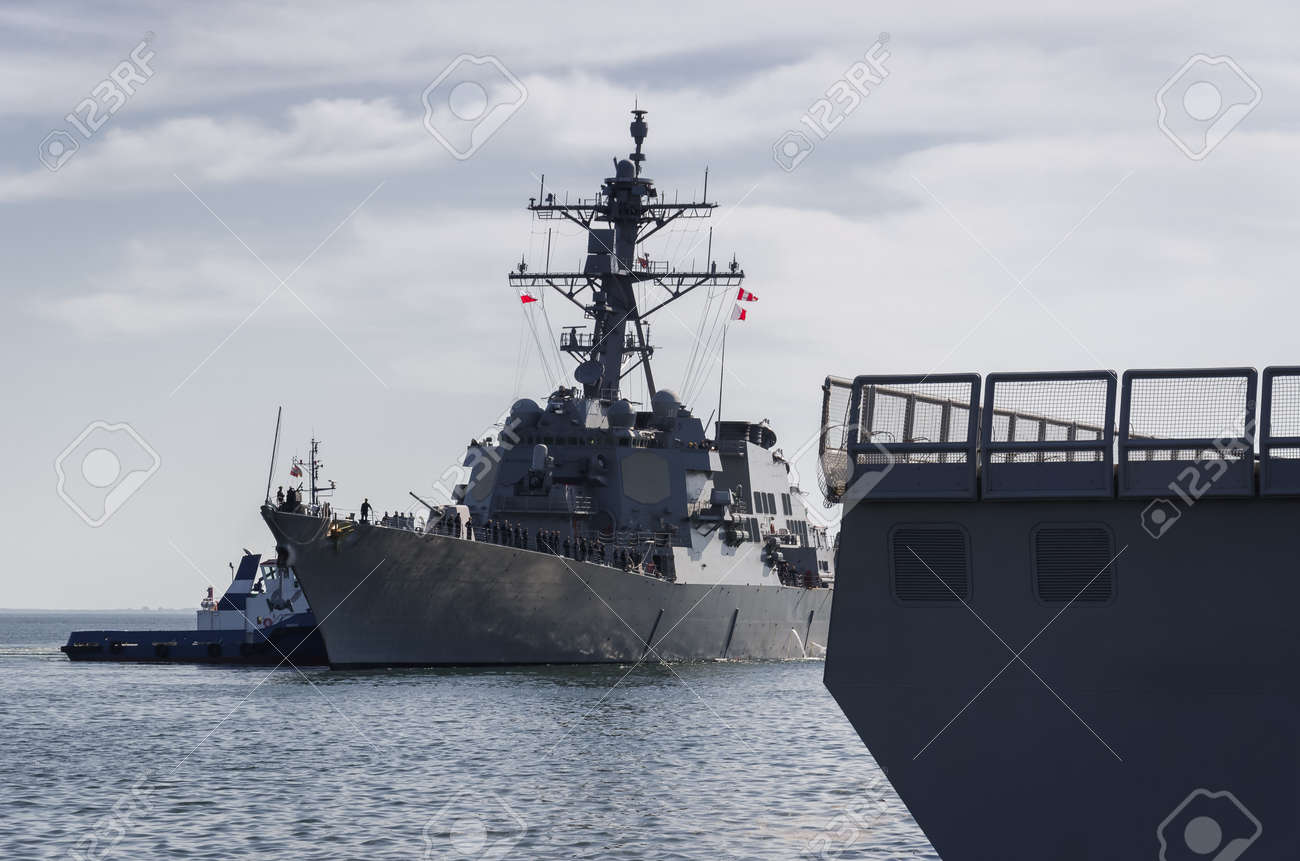 WARSHIPS - An Italian frigate and an American destroyer moored at a seaport wharf - 170922857