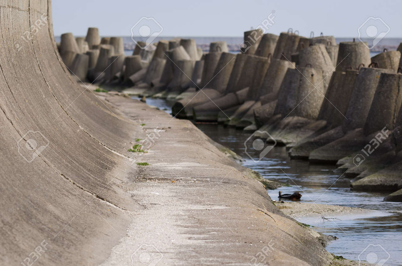 DOLOS AND BREAKWATER - Engineering structures protecting the port against sea waves - 171214269