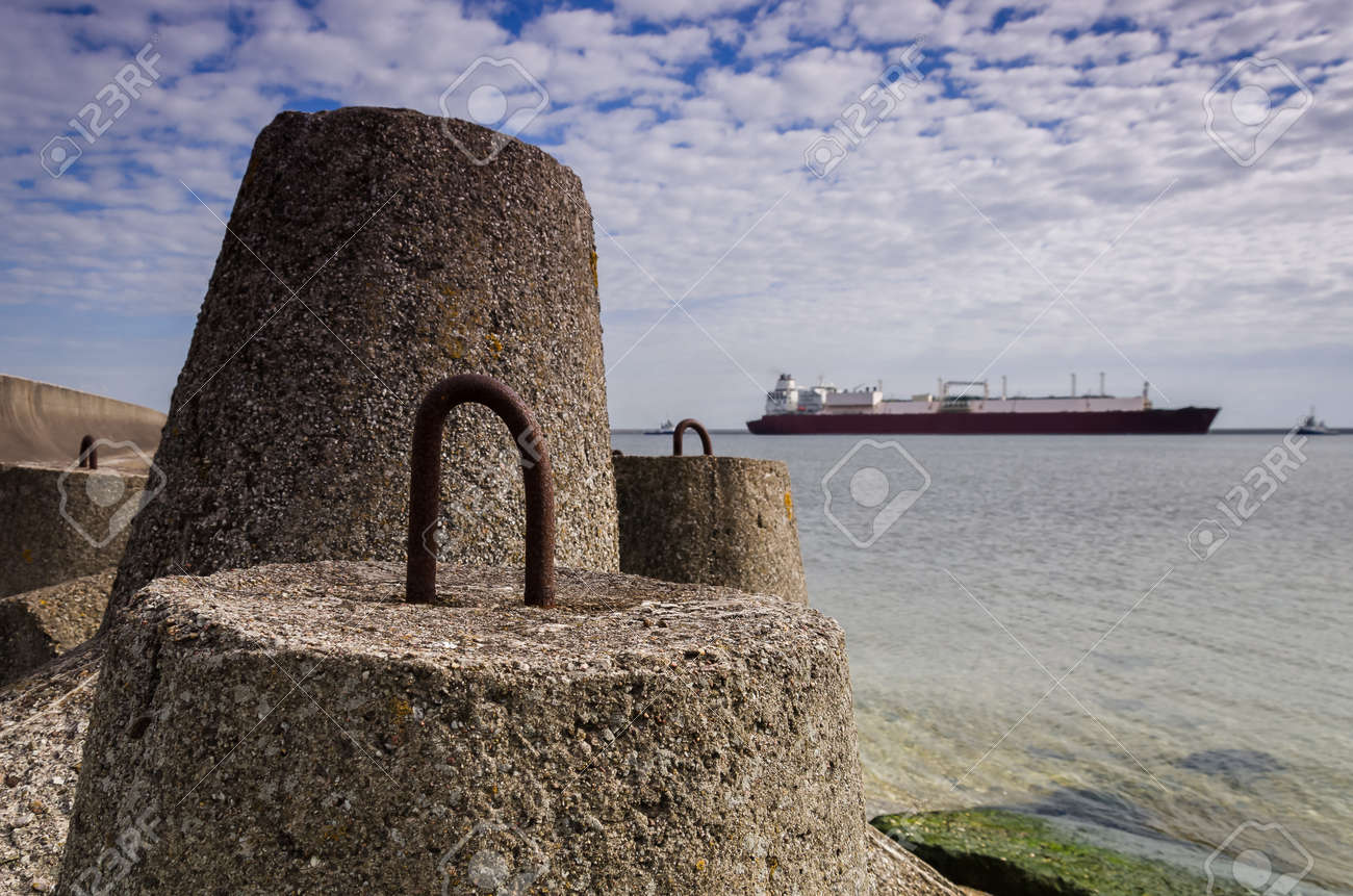 DOLOS AND LNG TANKER - Ship against background of concrete protection of the seaport and sea coast - 171257396