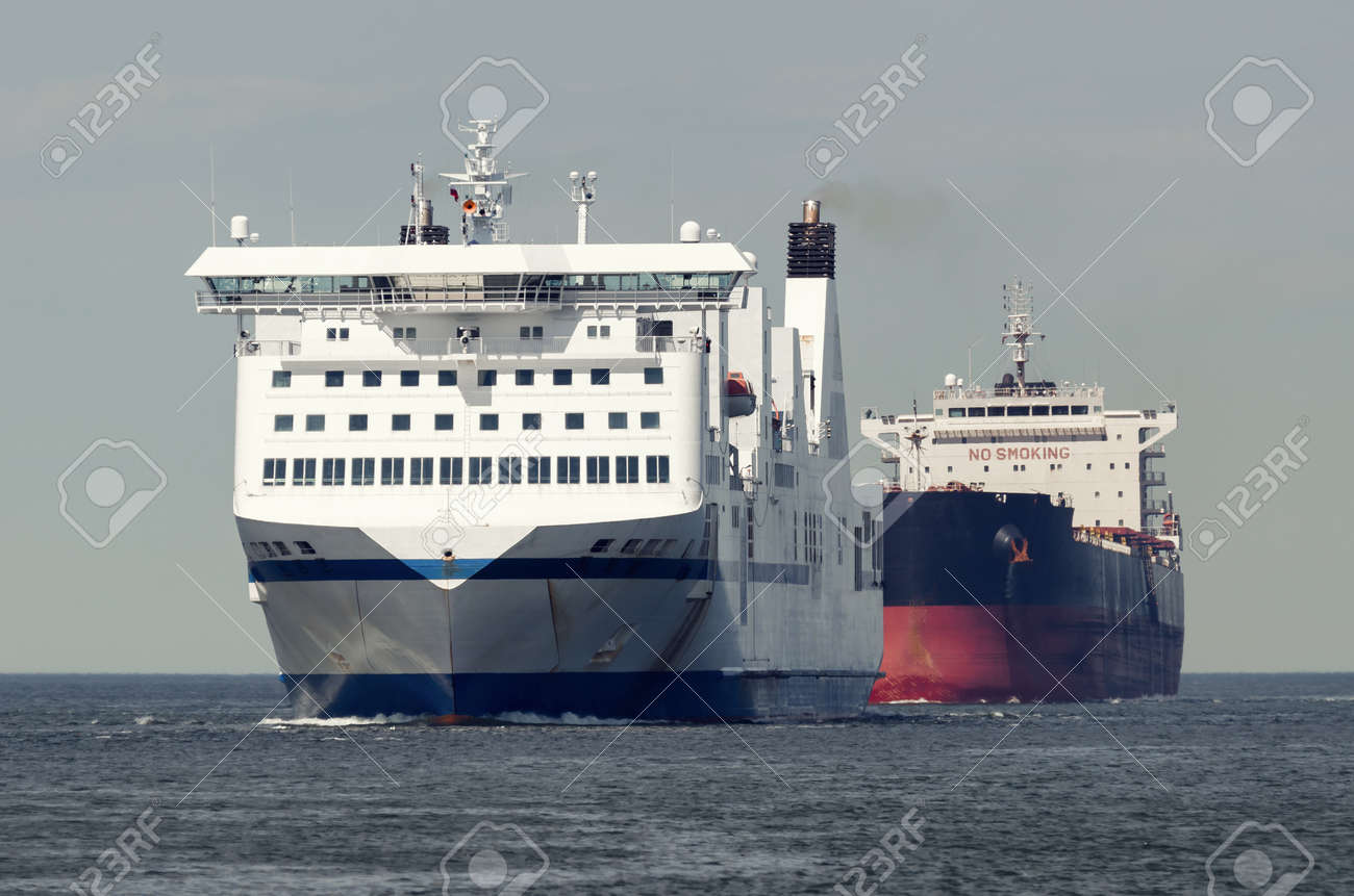 MARITIME TRANSPORT - Passenger ferry and bulk carrier on waterway to the port - 171410614
