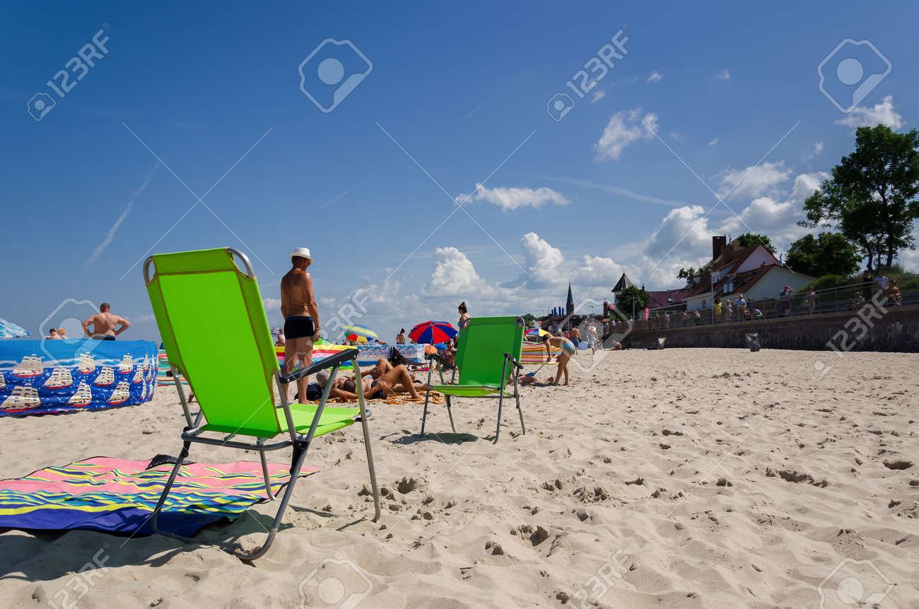 SARBINOWO, WEST POMERANIAN / POLAND - 2021: Holidaymakers relacreation on the sunny sea beach - 171646421