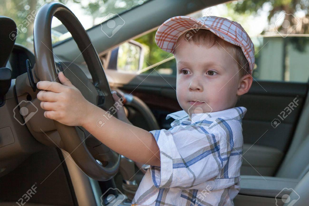 A boy wearing a cap while driving Standard-Bild - 14274354