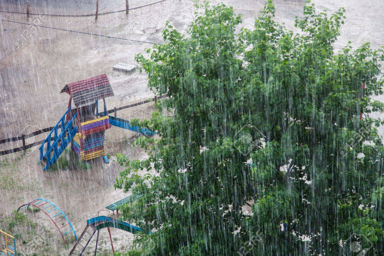 Heavy rain against the tree and a children Standard-Bild - 19847149