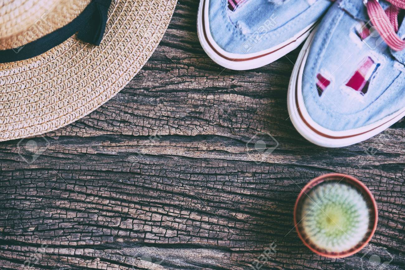 15c42a8b15b Stock Photo - the flat lay of the wooden background with the hat ,shoe and  cactus plant in vintage style