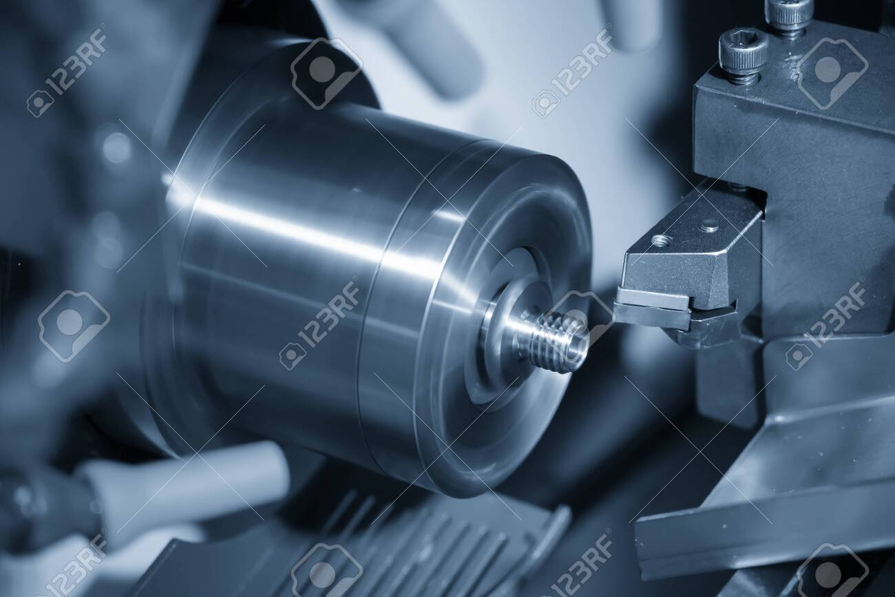 The CNC lathe cutting the thread at the metal parts. The hi-technology automotive parts manufacturing process by turning machine. - 120392408