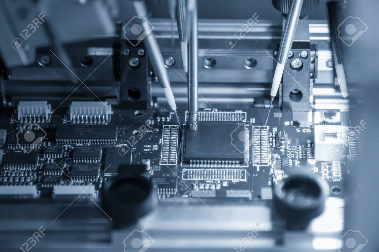 The main board assembly line operation by robotics system control by computer program. The hi-technology electronics industrial production line by automatic robot system. - 143976025
