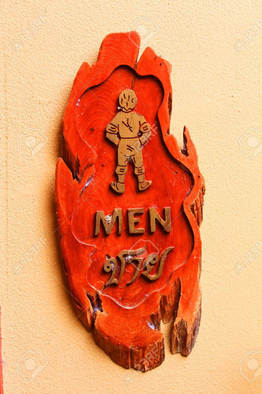 Man wooden carving vintage sign in Thai language Stock Photo - 22709600