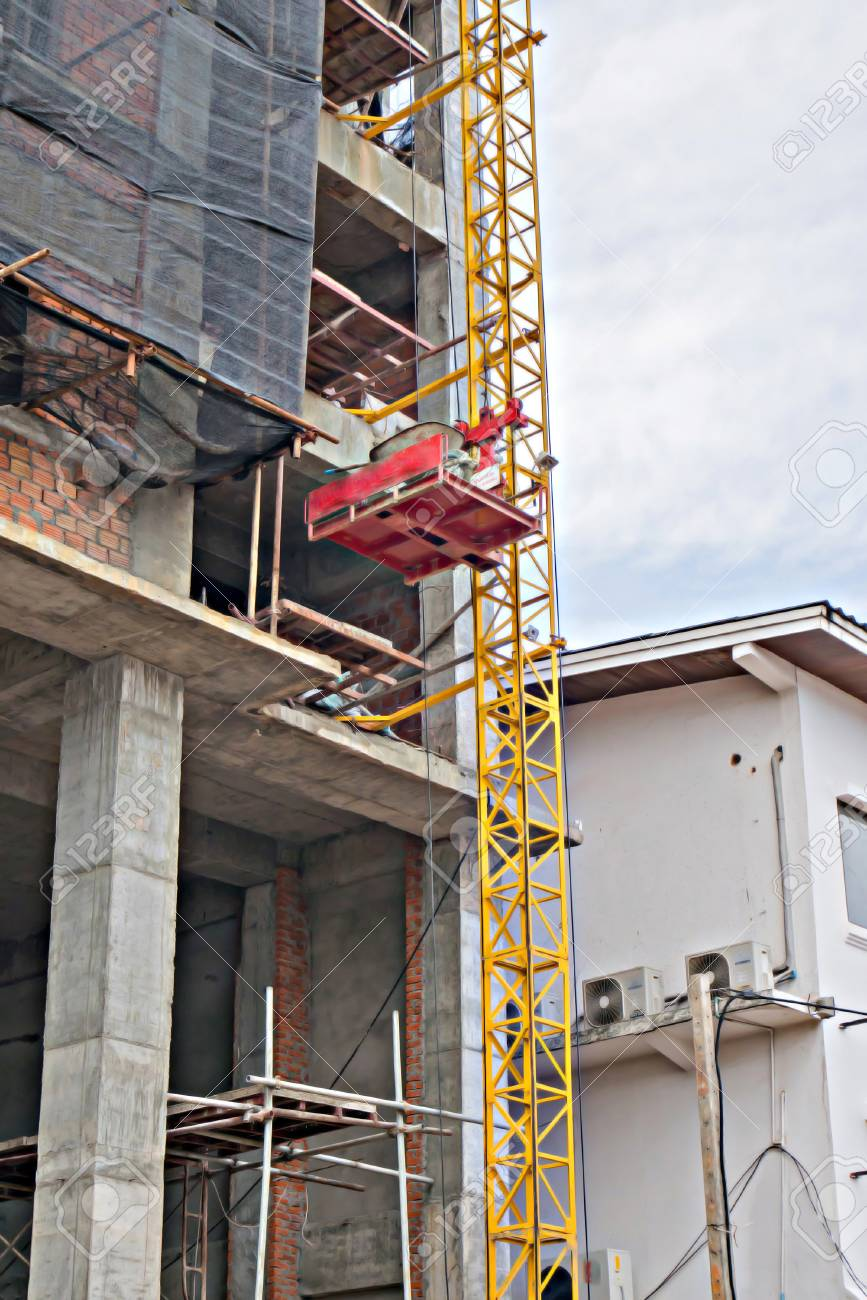 A Building Under Construction With An Elevator Lift Stock Photo