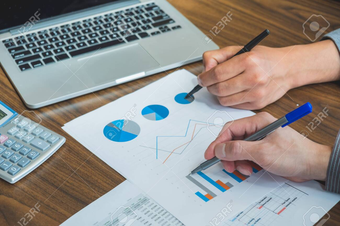 Business people discussing financial reports during the meeting - 151334805