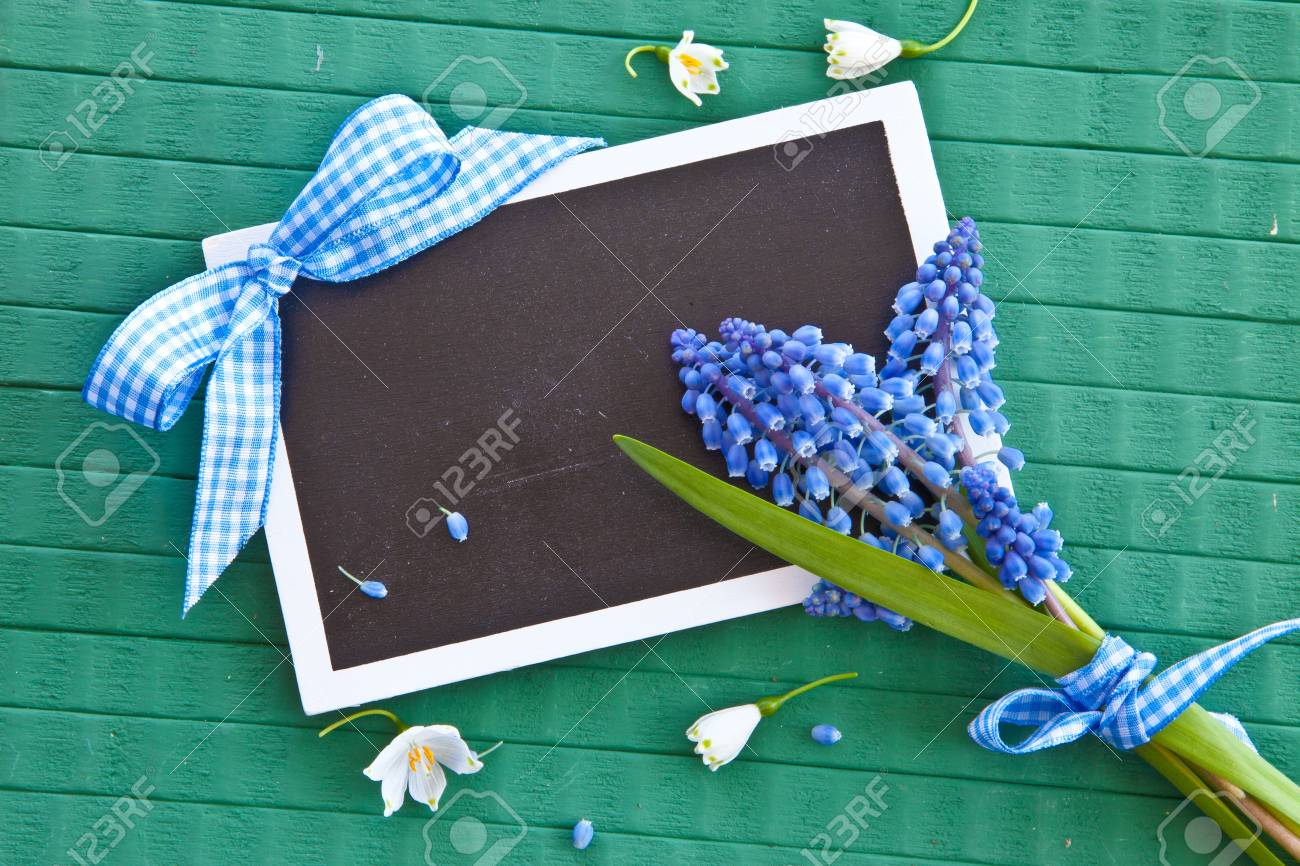 Fresh spring flowers on green rustic wooden background Stock Photo - 26562917