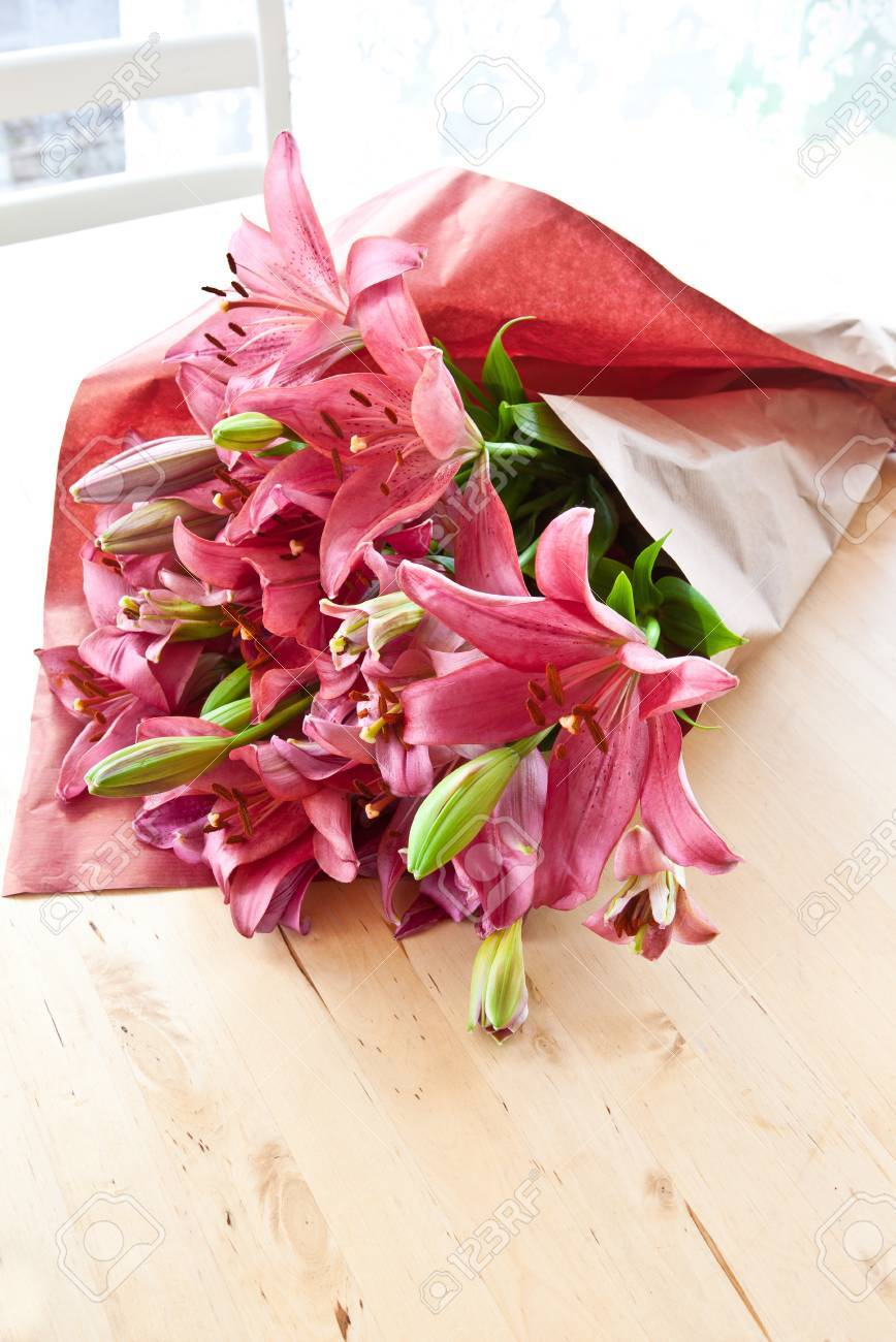 Fresh Pink Lilies Wrapped In Brown Paper Stock Photo Picture And