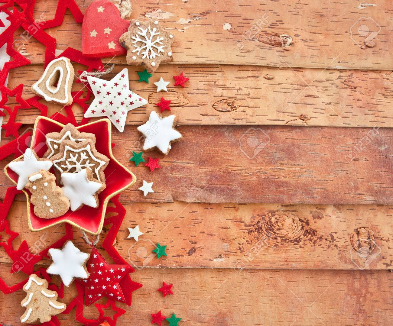 Christmas cookies and decorations won rustic wooden background
