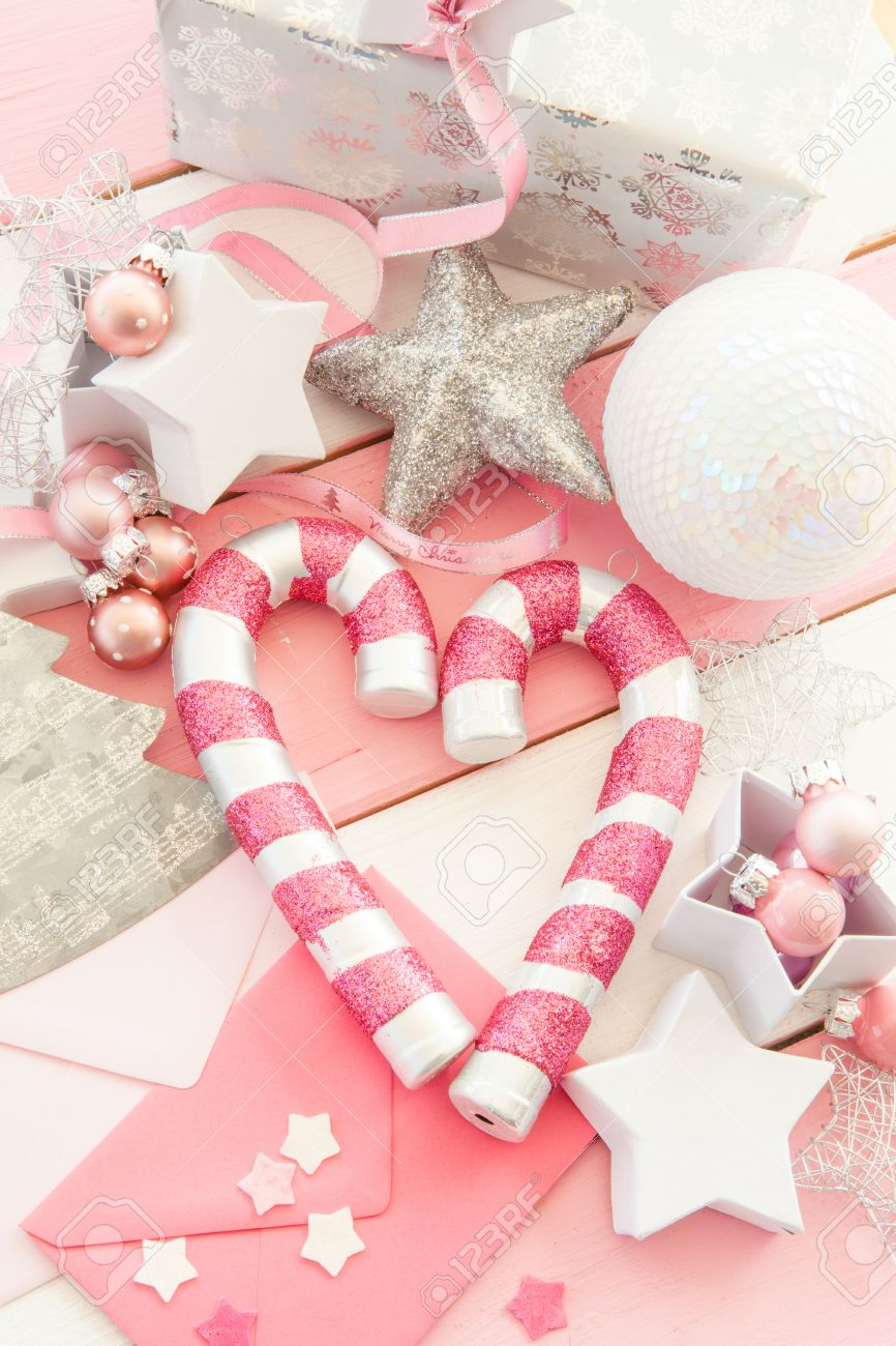 Pink Christmas Decorations With Glittery Ornaments On Striped Wooden  Background Stock Photo  42549985