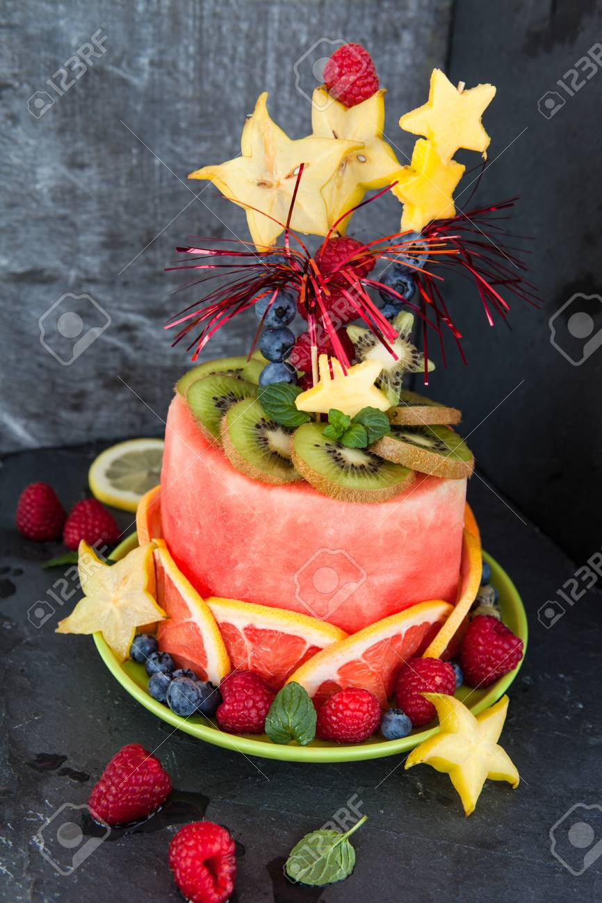 Colorful Cake Made From Fresh Fruits With Party Decorations Stock Photo