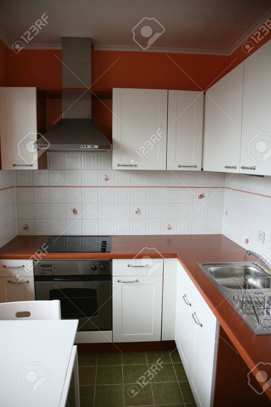Kitchenette with appliances in small apartment.