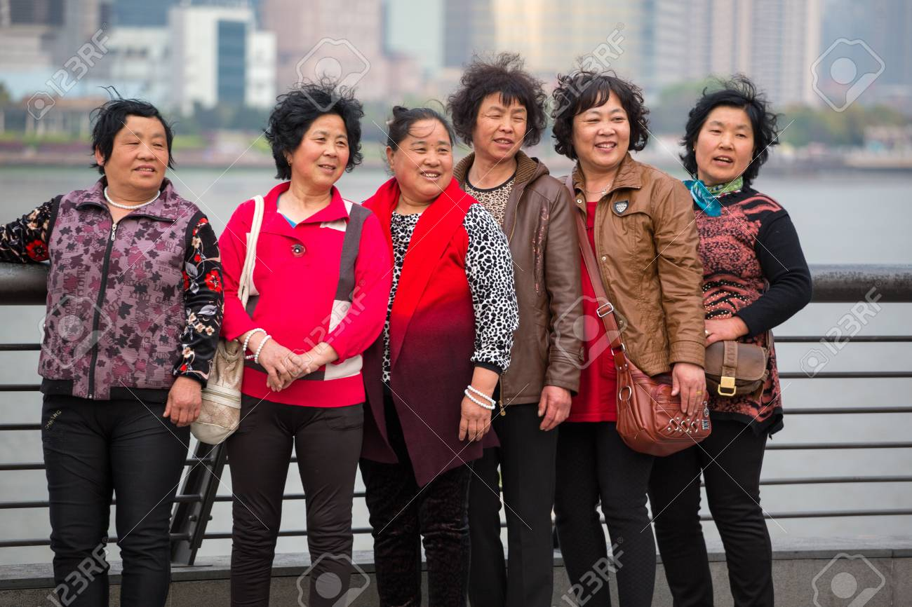 CHINA, SHANGHAI, APRIL 8: Unidentified group of women smailling and being taken in photo in Pudong, Shanghai, 8 April 2013 Stock Photo - 20552322