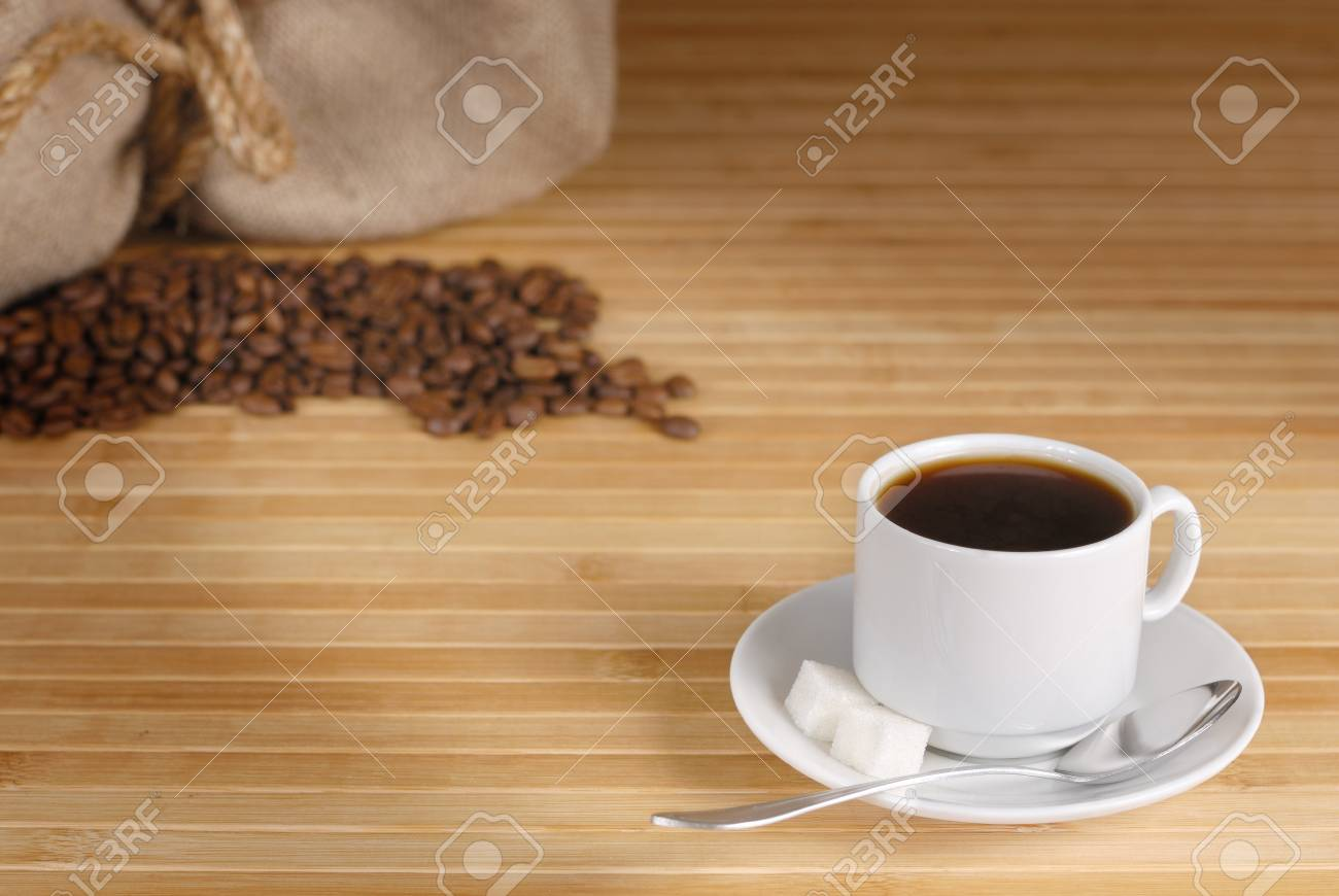 Coffee cup, beans and sack on the wooden table Stock Photo - 8766067