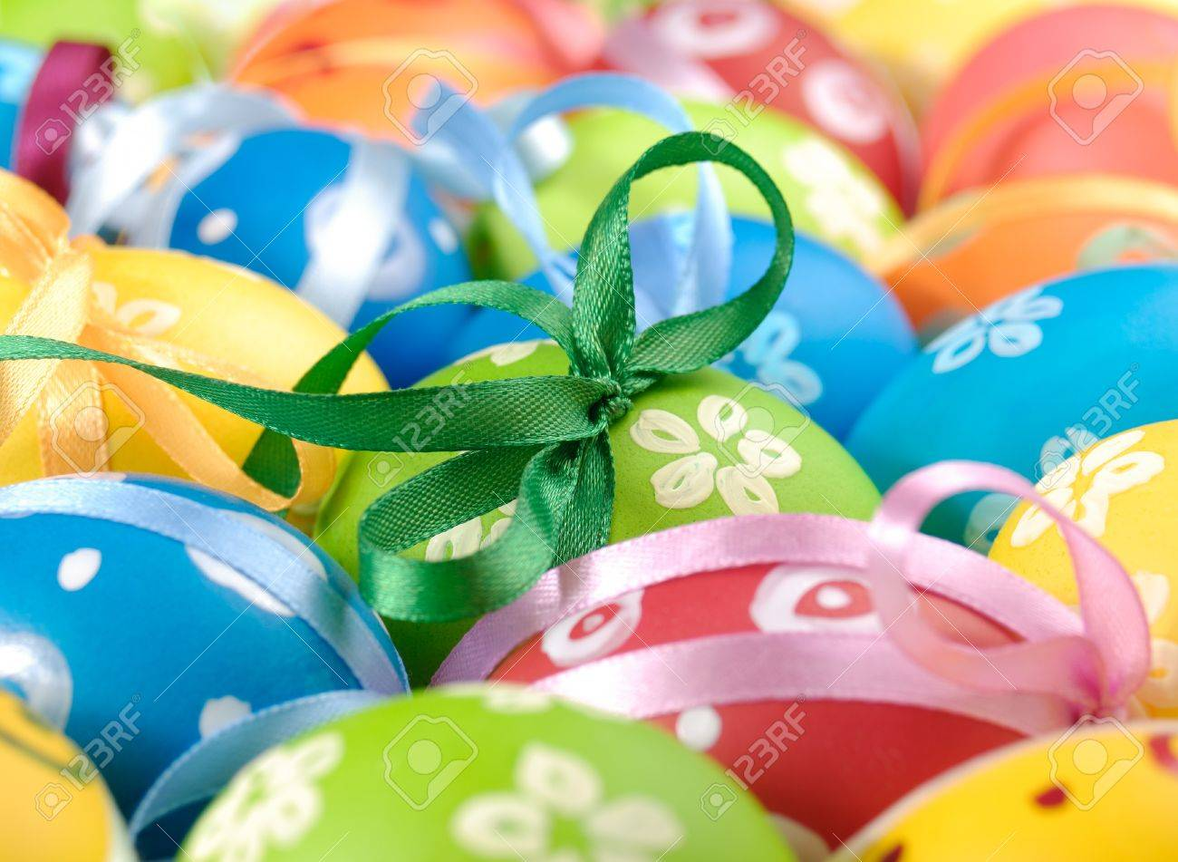 Painted easter eggs with bows uniform background Stock Photo - 8766064