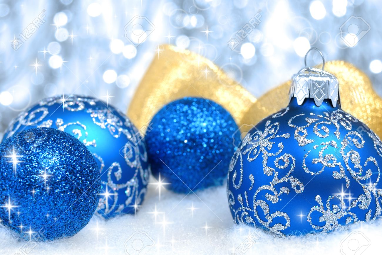 Blue christmas tree balls and golden ribbon over blurry background. Shallow depth of field Stock Photo - 9287732