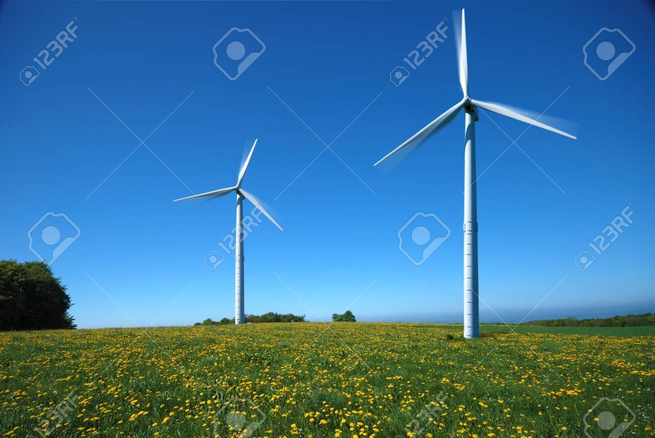Two electricity windmills under the clear blue sky Stock Photo - 9291237
