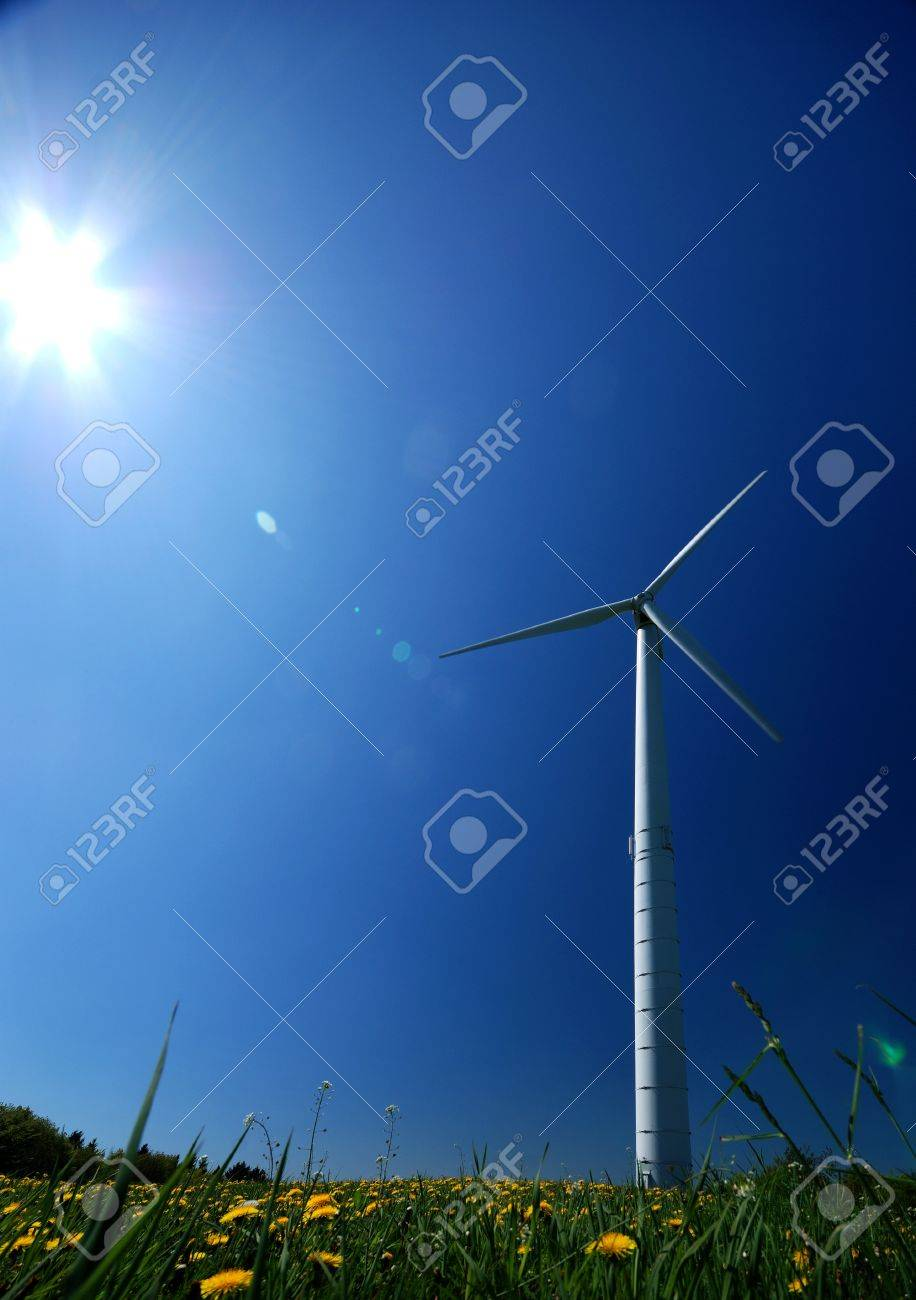 Electricity power wind generator pole against blue sky background Stock Photo - 9291084