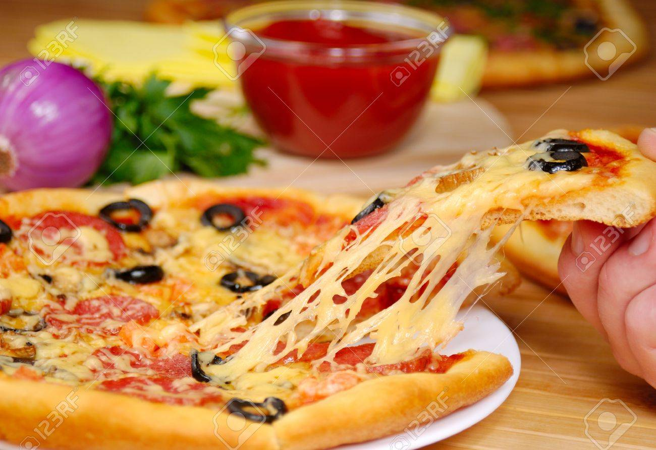 Pepperoni pizza with mushrooms, peppers and olives Stock Photo - 9355291