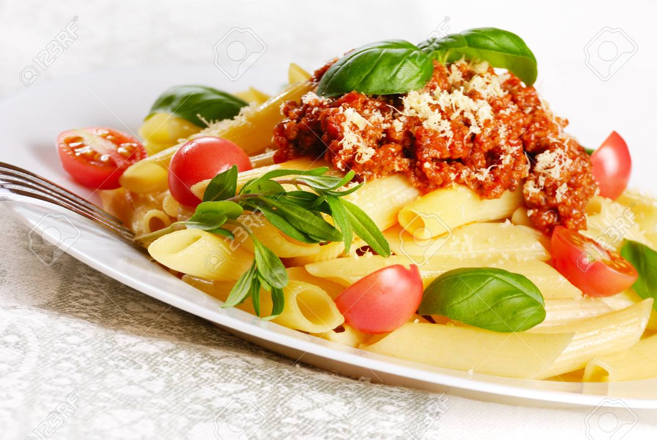 Rigatoni pasta with a tomato beef sauce and Parmigiano-Reggiano Stock Photo - 9738909