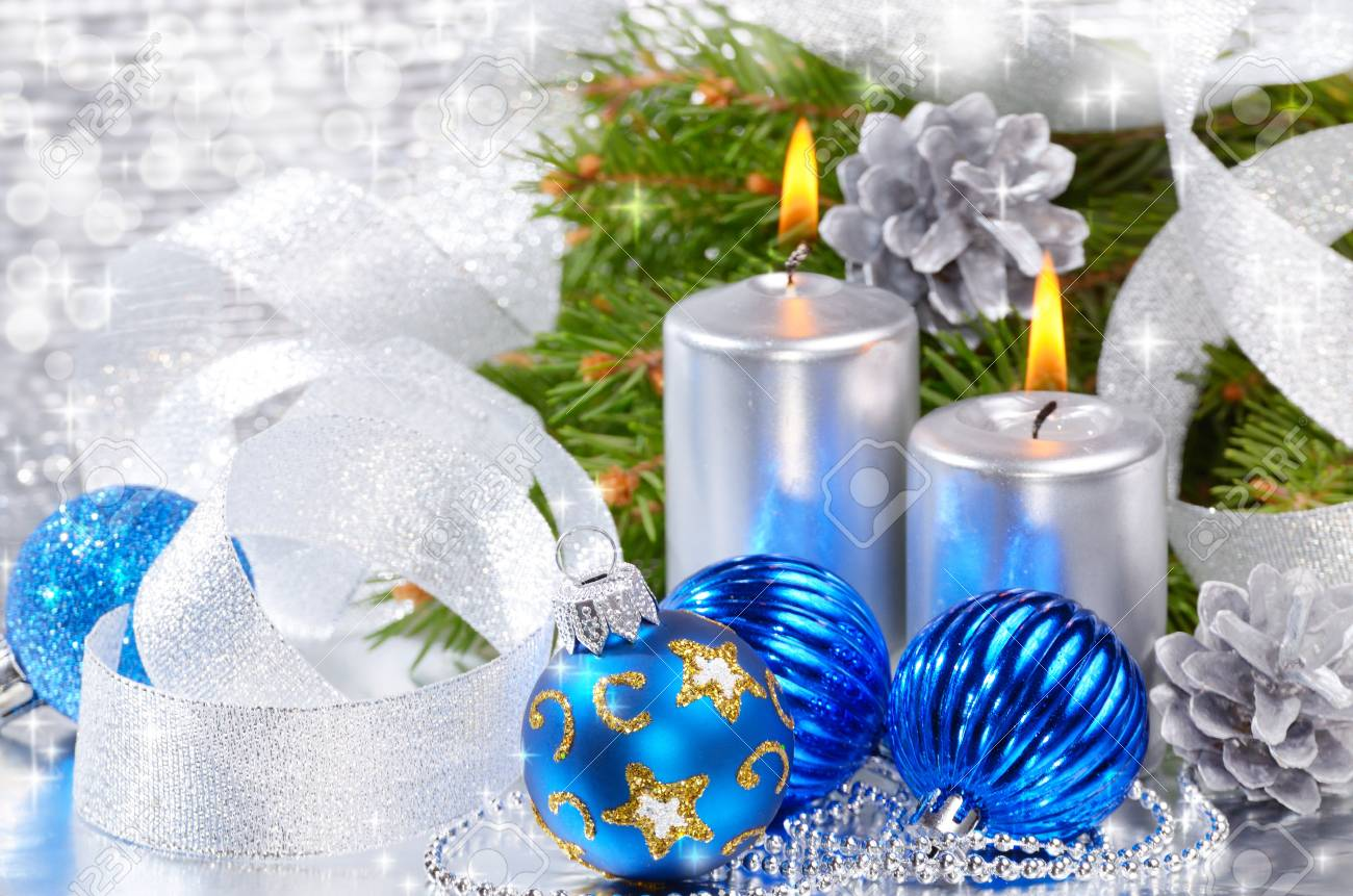 Blue Christmas balls with silver candles over bright background Stock Photo - 11294516