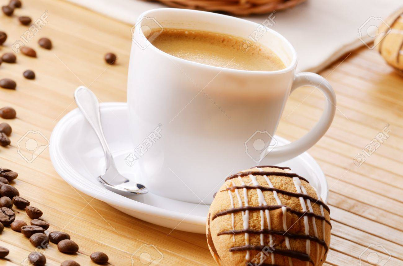 Cookie Coffee Cups Coffee Cup With Cookie Sandwich On The Table Stock Photo Picture
