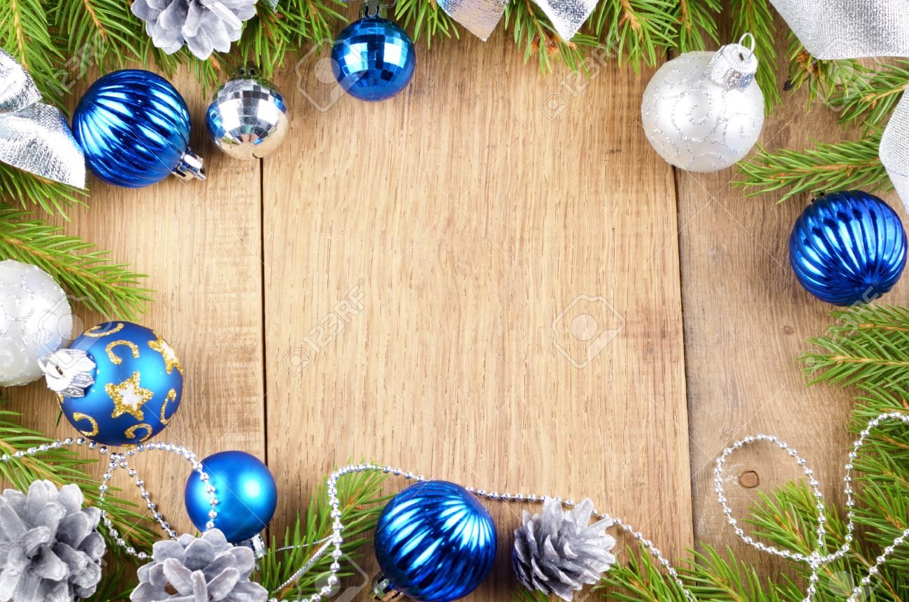 Christmas Background Of Blue And Silver Balls Over Wooden Table Stock Photo