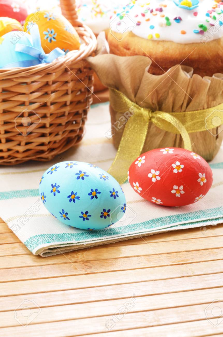 Easter eggs, cake and basket on the tabletop Stock Photo - 15309525