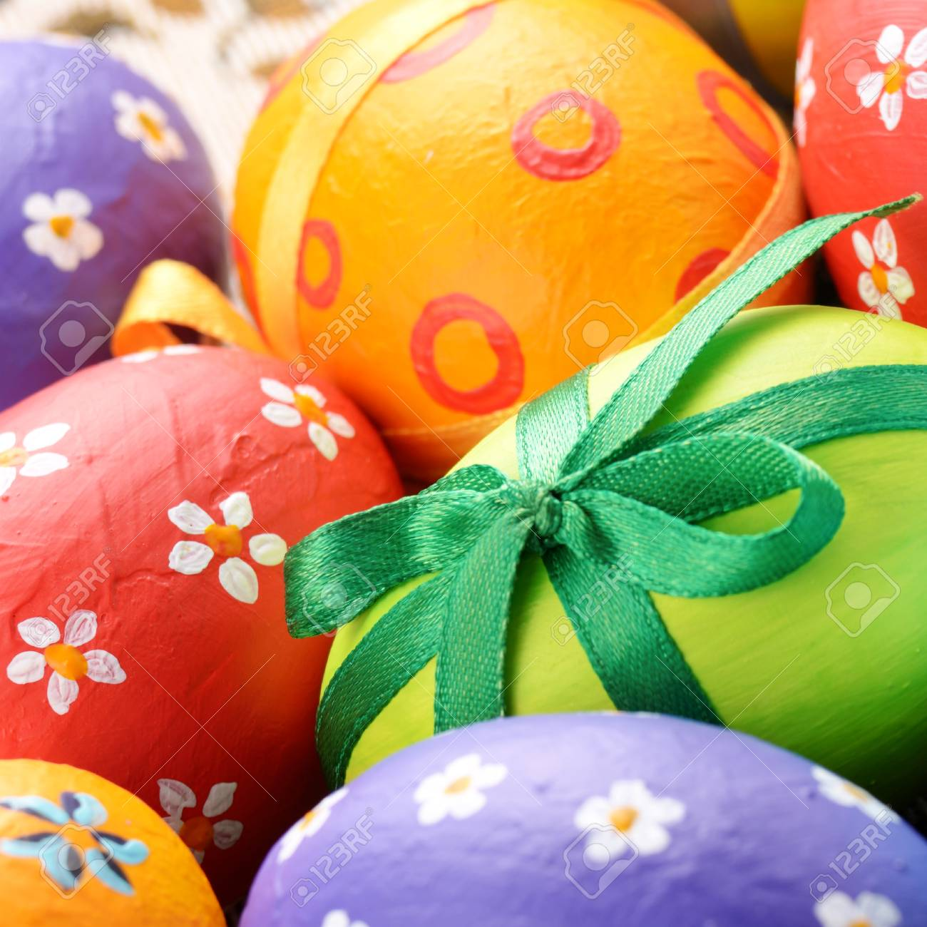 Painted easter eggs with bows background Stock Photo - 16132546