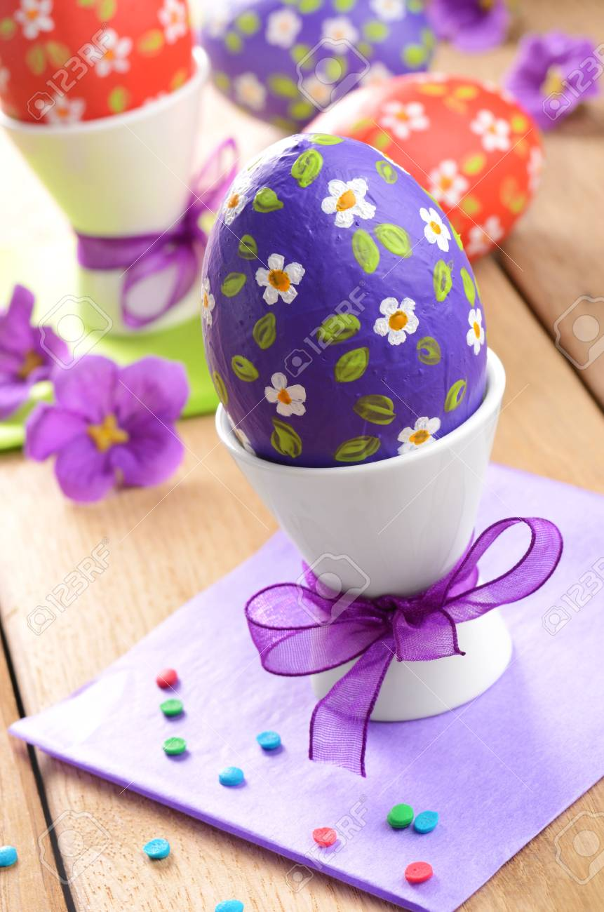 Hand crafted easter eggs on the wooden table Stock Photo - 16420502