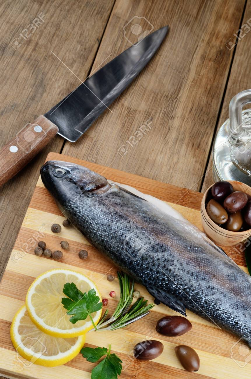 Raw trout on the chopping board with lemon and spices Stock Photo - 18656382