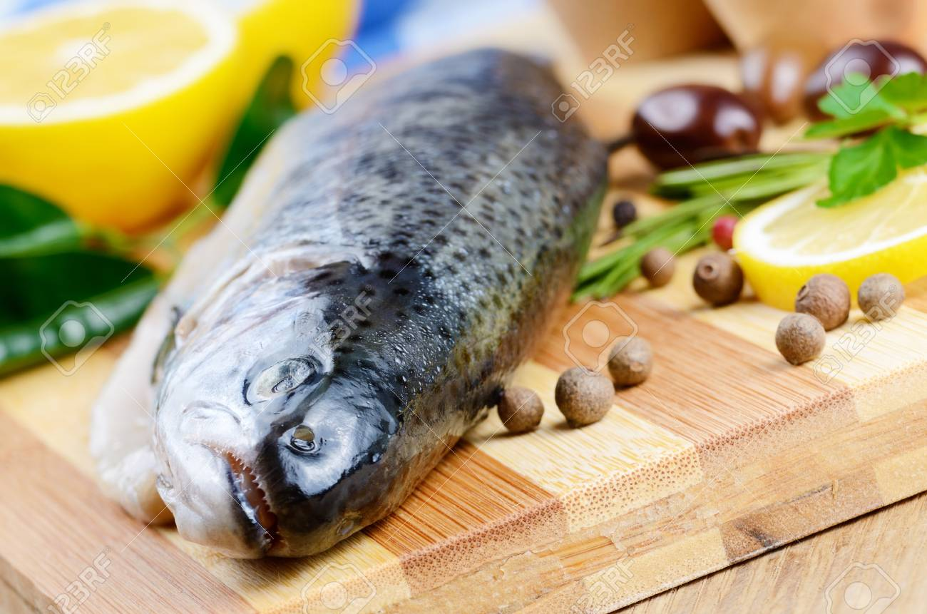 Raw trout on the chopping board with lemon and spices Stock Photo - 18992493