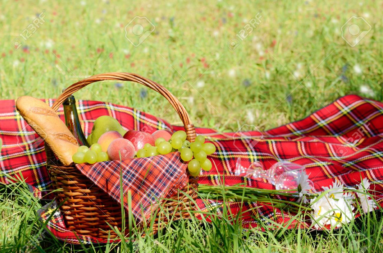 Picnic basket with red napkin fool of fruits, bread and wine Stock Photo - 18992504